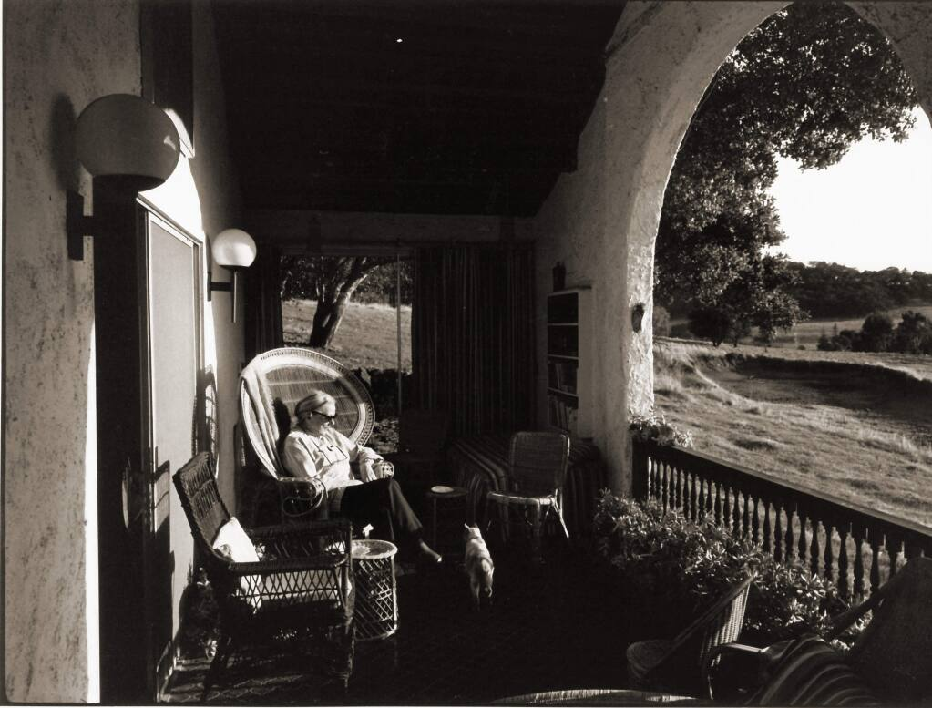 """At M.F.K. Fisher's """"Last House"""" on the Bouverie Preserve in Glen Ellen, Fisher is seen relaxing in one of the arched porches that looked out on land protected by Audubon Canyon Ranch in an undated photo. Described by W. H. Auden as """"America's greatest writer,"""" Fisher lived from 1908 to 1992. (Audubon Canyon Ranch)"""