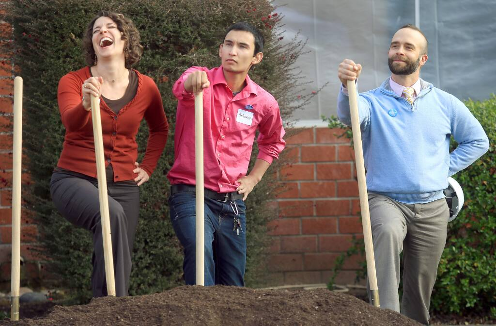 From left, Social Advocates for Youth Chief Development Officer Cat Cvengros busts up while posing for a photo with SAY client Antonio Suttie and SAY Executive Director Matt Martin on Wednesday, March 11, 2015 at the official groundbreaking of the Dream Center in Santa Rosa. (KENT PORTER/ PD)