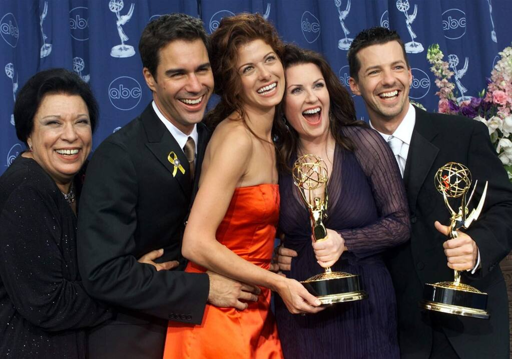 "FILE - In this Sept. 10, 2000, file photo, Shelley Morrison, from left, Eric McCormack, Debra Messing, Megan Mullally and Sean Hayes celebrate their awards for their work in 'Will & Grace' at the 52nd annual Primetime Emmy Awards in Los Angeles. Morrison, an actress with a 50-year career who was best known for playing a memorable maid on ""Will and Grace,"" has died. Publicist Lori DeWaal says Morrison died Sunday, Dec. 1, 2019, at Cedars-Sinai Medical Center in Los Angeles from heart failure. She was 83. (AP Photo/Kevork Djansezian, File)"