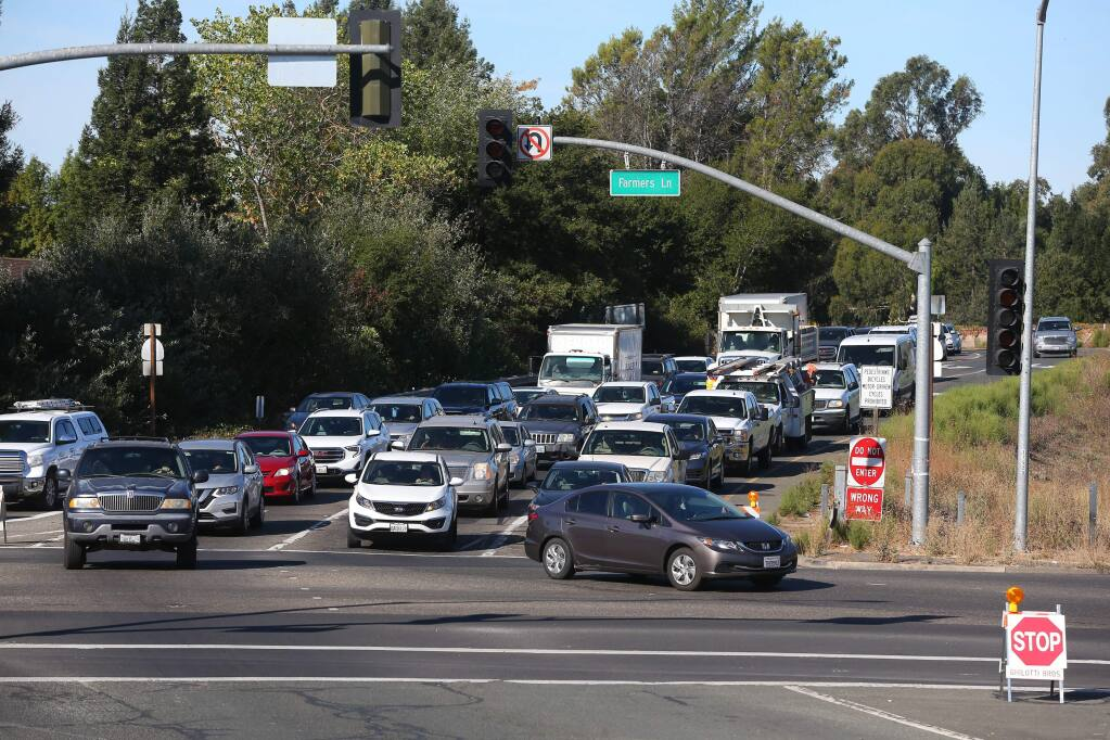 Traffic backs up along Highway 12 at Farmers Lane with the traffic signals being off due to the PG&E power shutdown in Santa Rosa on Thursday, October 10, 2019. (Christopher Chung/ The Press Democrat)