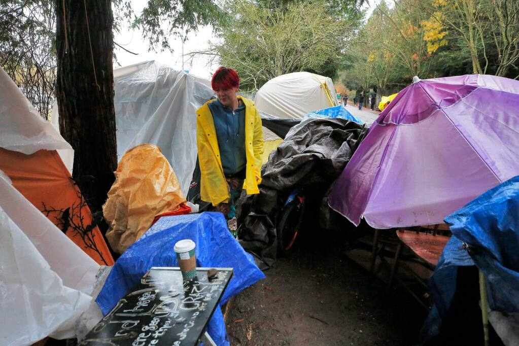 Nicholle Vannucchi stands beside the tent she lives in with her fiancé at the homeless ?encampment along Joe Rodota Trail in Santa Rosa on Dec. 4. (ALVIN JORNADA / The Press Democrat)