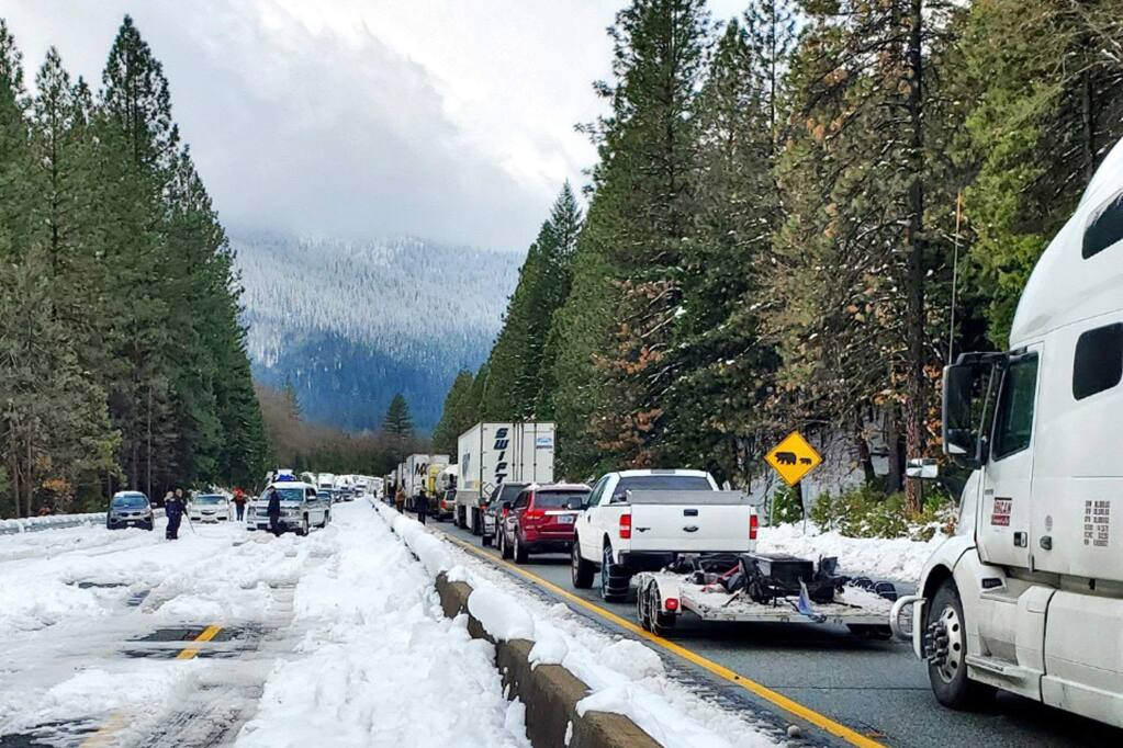 This photo provided by Caltrans shows cars and trucks in stopped traffic on Interstate 5 near Dunsmuir, Calif., Wednesday, Nov. 27, 2019. Thanksgiving travel has been snarled in some places by two powerful storms. A winter storm blamed for one death and hundreds of canceled flights in the West moved into the Midwest on Wednesday and dropped close to a foot of snow in parts of Minnesota and Wisconsin. (Caltrans via AP)