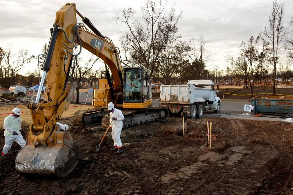 An excavator crew from Ghilotti Construction Company finishes clearing the burned debris and concrete from a property in the Coffey Park neighborhood in Santa Rosa, California on Tuesday, November 28, 2017. (Alvin Jornada / The Press Democrat)