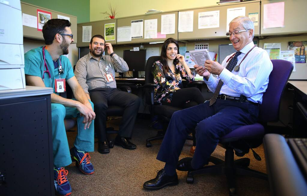 Dr. Gustavo Enrique Gonzalez-Mendez, right, meets with resident physicians Dr. Afsoon Foorohar, Dr. Guillermo Padilla and Dr. Brandon Cortez, as part of the Santa Rosa Family Medicine Residency Program, at the Vista Family Health Center, in Santa Rosa, on Wednesday, August 17, 2016. (Christopher Chung/ The Press Democrat)