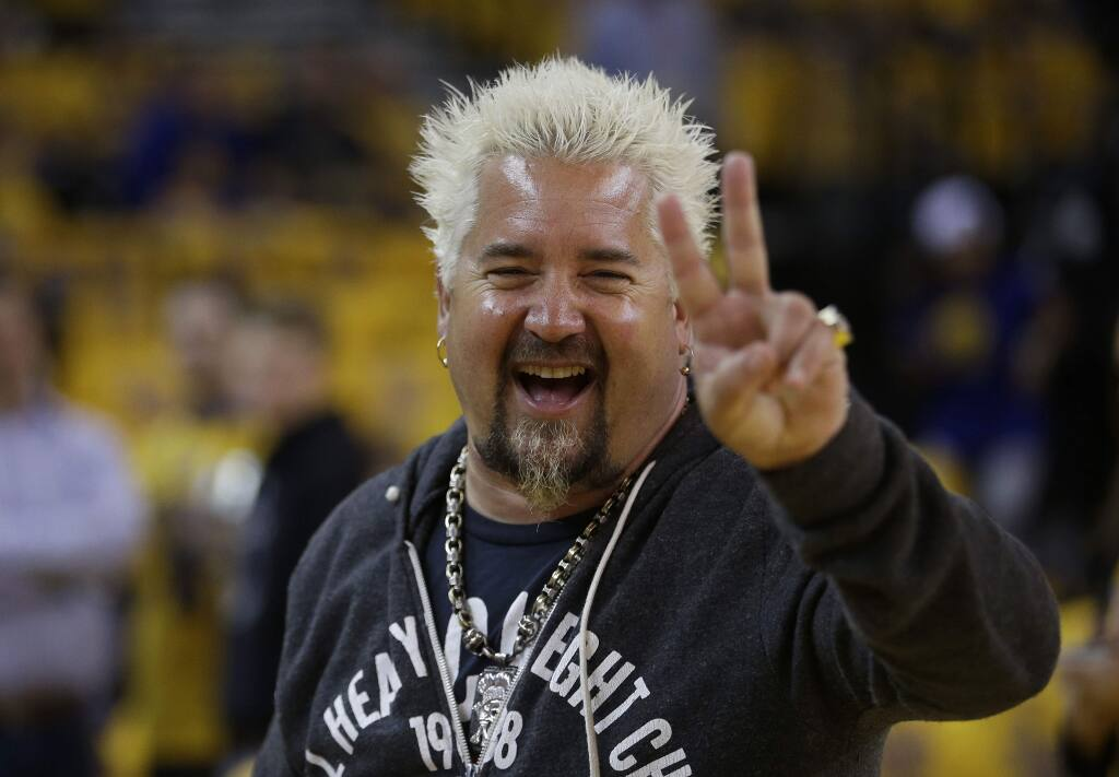Celebrity chef Guy Fieri smiles before Game 2 of the NBA basketball Western Conference finals between the Golden State Warriors and the Houston Rockets in Oakland, Calif., Thursday, May 21, 2015. (AP Photo/Rick Bowmer)