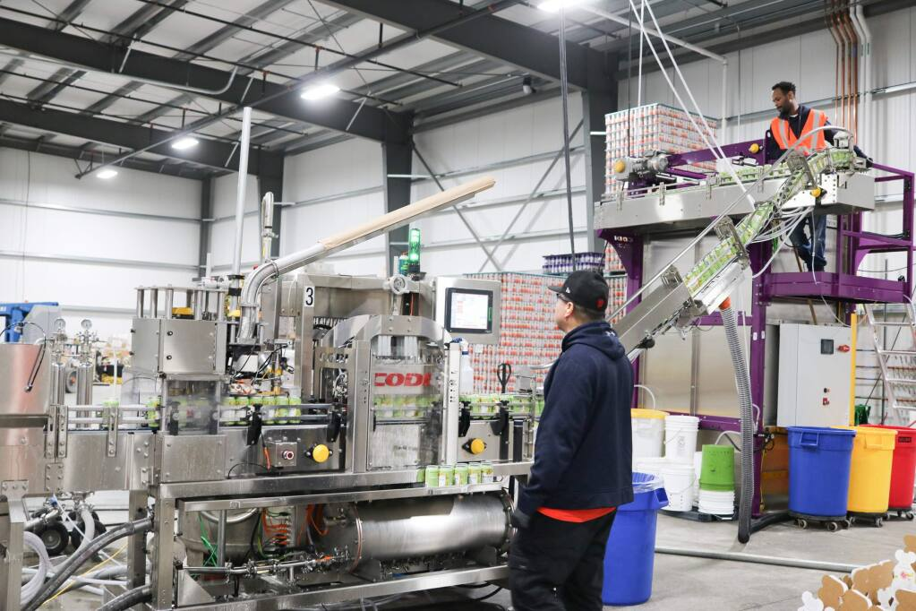 Free Flow Wines's Sonoma facility, opened in February 2019, has lines like this one that can fill up to 5 million cases of canned wine and other adult beverages annually. (COURTESY OF FREE FLOW WINES)
