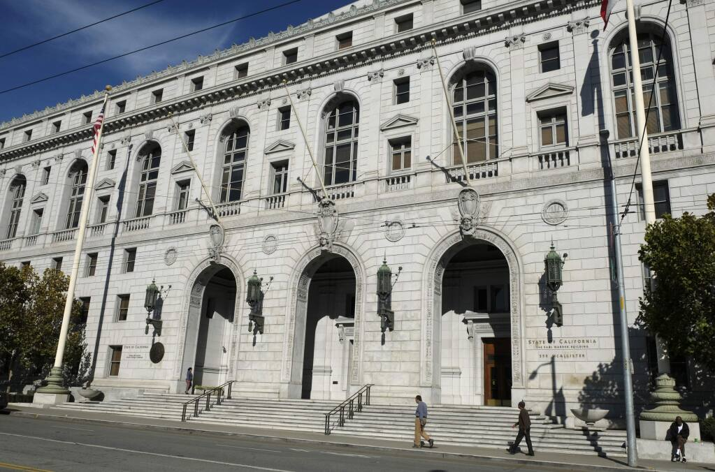 In this Nov. 2, 2018, file photo, people walk past the Earl Warren Building that houses the California Supreme Court in San Francisco. (AP Photo/Eric Risberg, File)