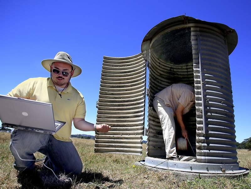 Sonoma County Water Agency employees George Howard, left and John Mendoza monitor a water well off Todd Road in Santa rosa, Wednesday July 10, 2013. The well tops are in the silo. (Kent Porter / Press Democrat) 2013