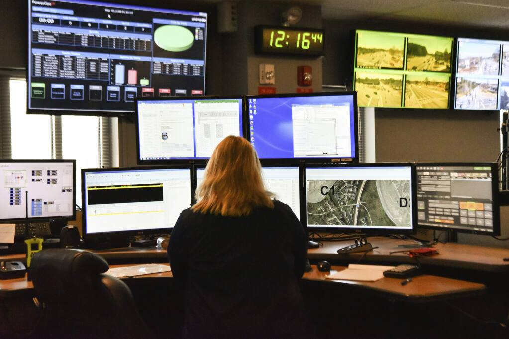 A dispatcher works at a desk station with a variety of screens used by those who take 911 emergency calls. (Lisa Marie Pane / Associated Press, 2018)