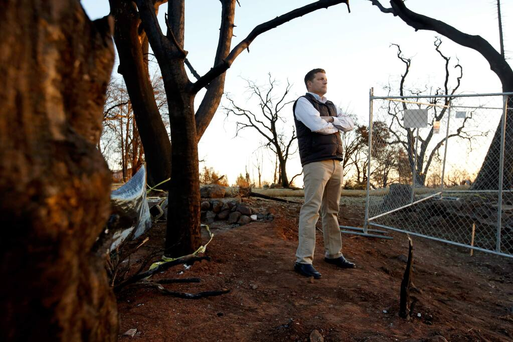 Robert Bivin poses for a portrait where his home stood on Stony Oak Court before it was destroyed in the Tubbs Fire, in the Fountaingrove neighborhood of Santa Rosa, California on Thursday, December 21, 2017. Bivin is one of 10 USAA insurance customers who are suing the provider for its deficient coverage and claim work in the aftermath of the October wildfires. (Alvin Jornada / The Press Democrat)