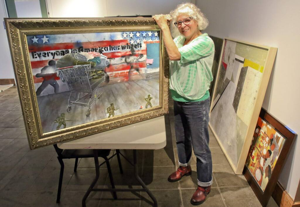 Evelyn Nitzberg of Petaluma delivers her painting 'Everyone in America has Wheels' to the Petaluma Art Center to be part of the Zeitgeist show on Wednesday, May 4, 2016. (SCOTT MANCHESTER/ARGUS-COURIER STAFF)