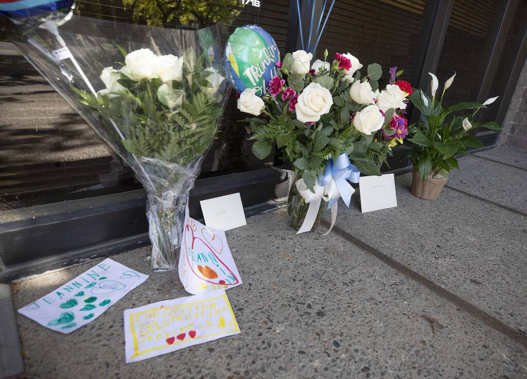 A memorial of flowers and notes fat the Santa Rosa Police office for Detective Mary Lou Armer, who died Tuesday of complications caused by the coronavirus. (photo by John Burgess/The Press Democrat)