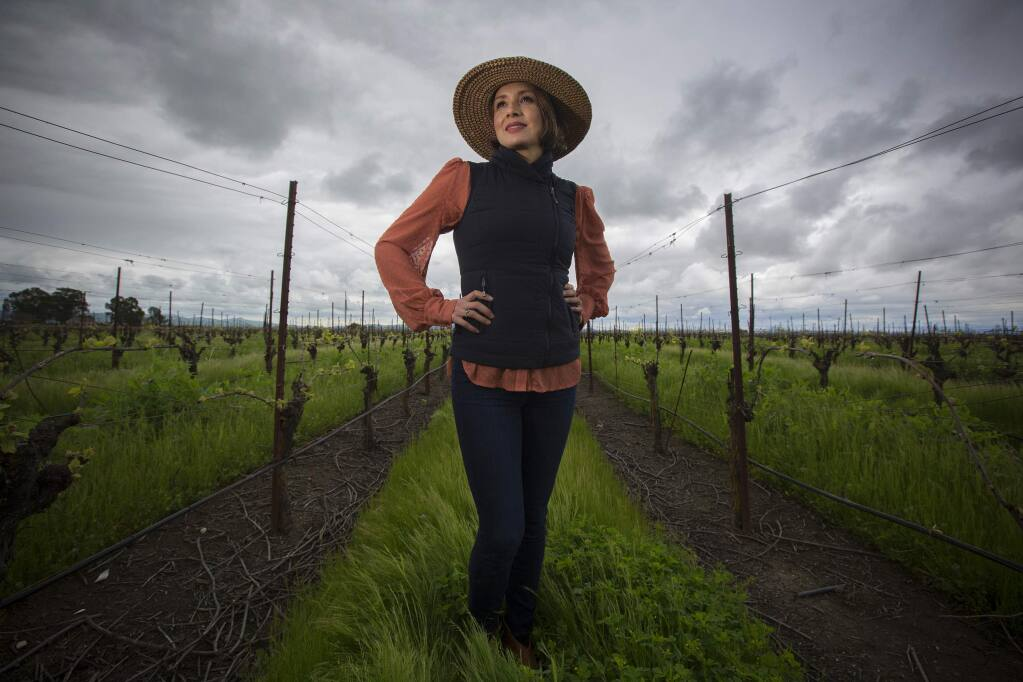 Vanessa Robledo in her vineyard off of Ramal Road in the Carneros region. (Photo by Robbi Pengelly/Index-Tribune)