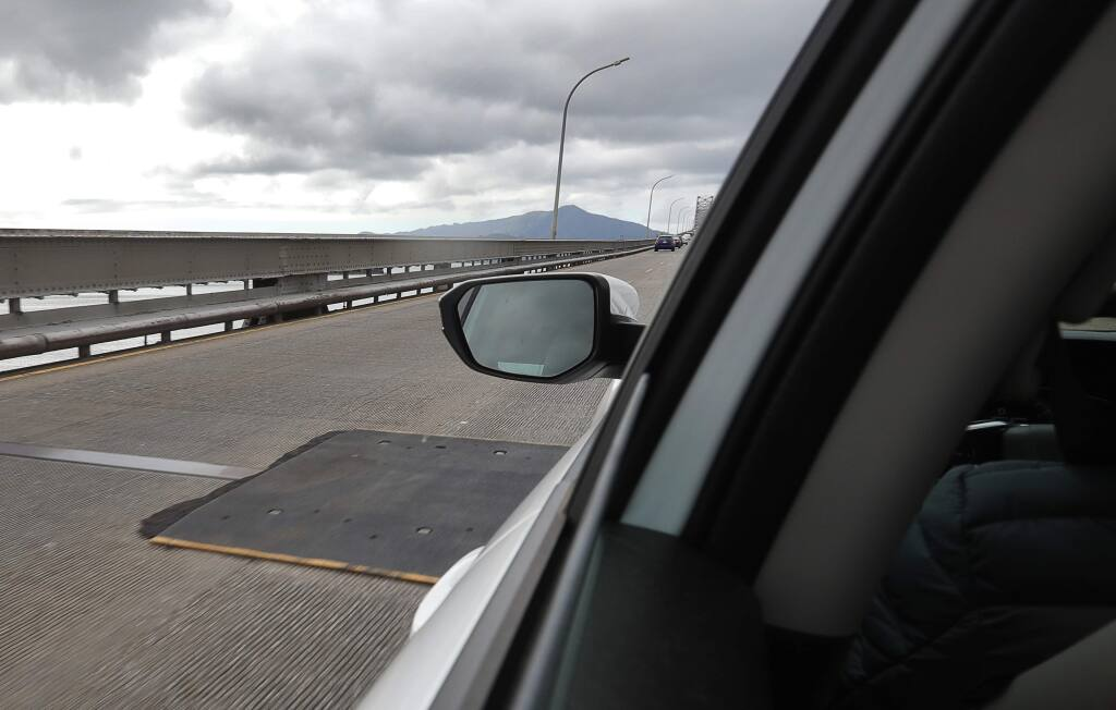 An eight-foot metal plate covers the expansion joint until permanent repairs can be completed on the Richmond-San Rafael Bridge, on Monday, Feb. 11, 2019. The permanent repair work is scheduled to start the week of Feb. 18.(Christopher Chung/ The Press Democrat)