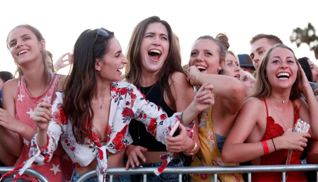 Concertgoers sing and dance as Thomas Rhett performs live on stage during Country Summer at the Sonoma County Fairgrounds in Santa Rosa, California on Friday, June 16, 2017. (Alvin Jornada / The Press Democrat)