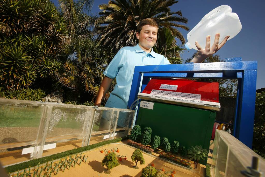 Steven McDowell, 15, demonstrates how his water fence collects rain water and stores water at his home in Rohnert Park on Wednesday, September 3, 2014. The Tech High student has received interest in the idea and will be unveiling it next month at the Greenbuild Expo in New Orleans. (Conner Jay/The Press Democrat)