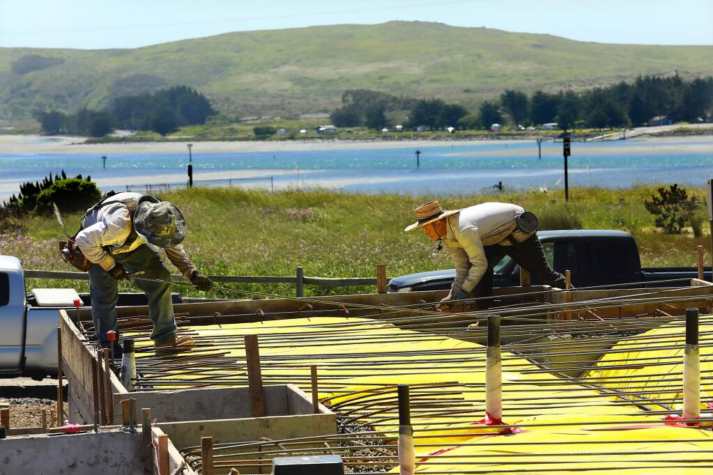 Workers place rebar for cement foundations for 70 homes in the Harbor View subdivision in Bodega Bay that has been stalled for three decades. (John Burgess/The Press Democrat)