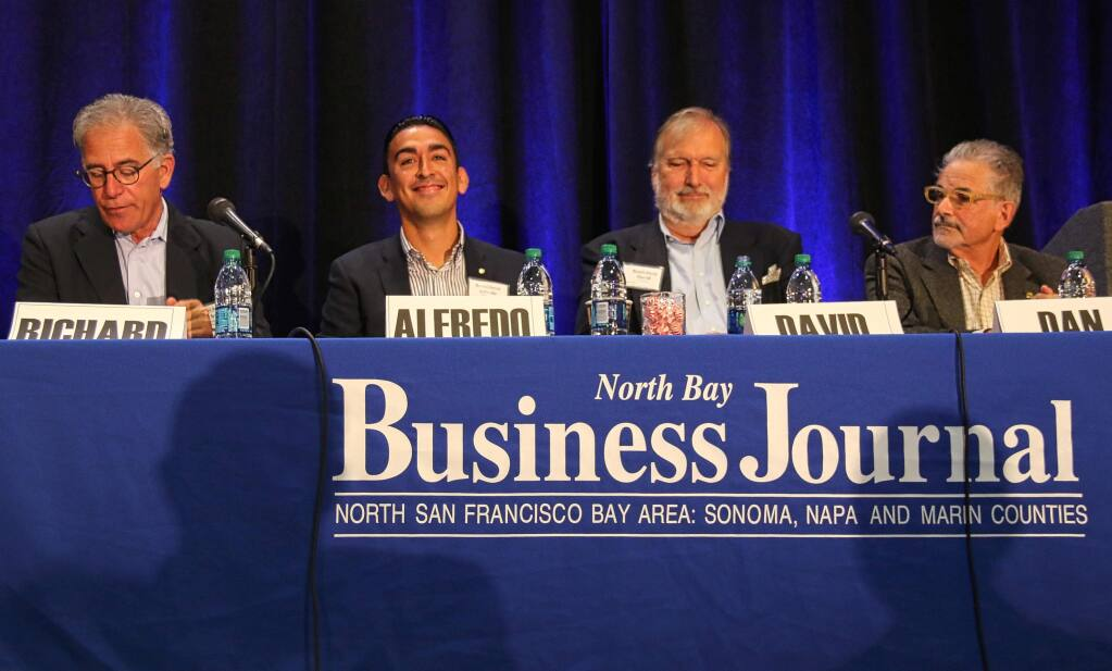 Napa-based wine attorney Richard Mendelson, left, moderates a panel discussion on challenges for Napa Valley growth, during North Bay Business Journal's Impact Napa conference held at The Meritage Resort & Spa on Aug. 5, 2016. Panelists are, from left, Alfredo Pedroza, Napa County supervisor; David Graves, Saintsbury winery; Dan Mufso, Napa Vision 2050. (JEFF QUACKENBUSH / NORTH BAY BUSINESS JOURNAL)