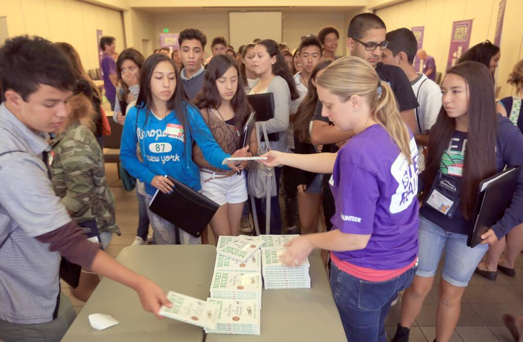 Literature is handed out during a seminar for disadvantaged kids, Friday Aug. 1, 2014 at Sonoma State University in Rohnert Park. (Kent Porter / Press Democrat)