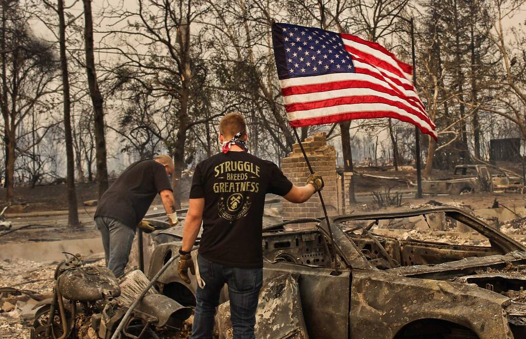 Logan Conner, 18, and his father Will Conner sift through the remains of their home off Coffey Lane during the aftermath of the Tubbs fire in Santa Rosa, Tuesday Oct. 10, 2017. Logan Conner is a 2017 graduate of Windsor High School. (Mac Porter Photography)