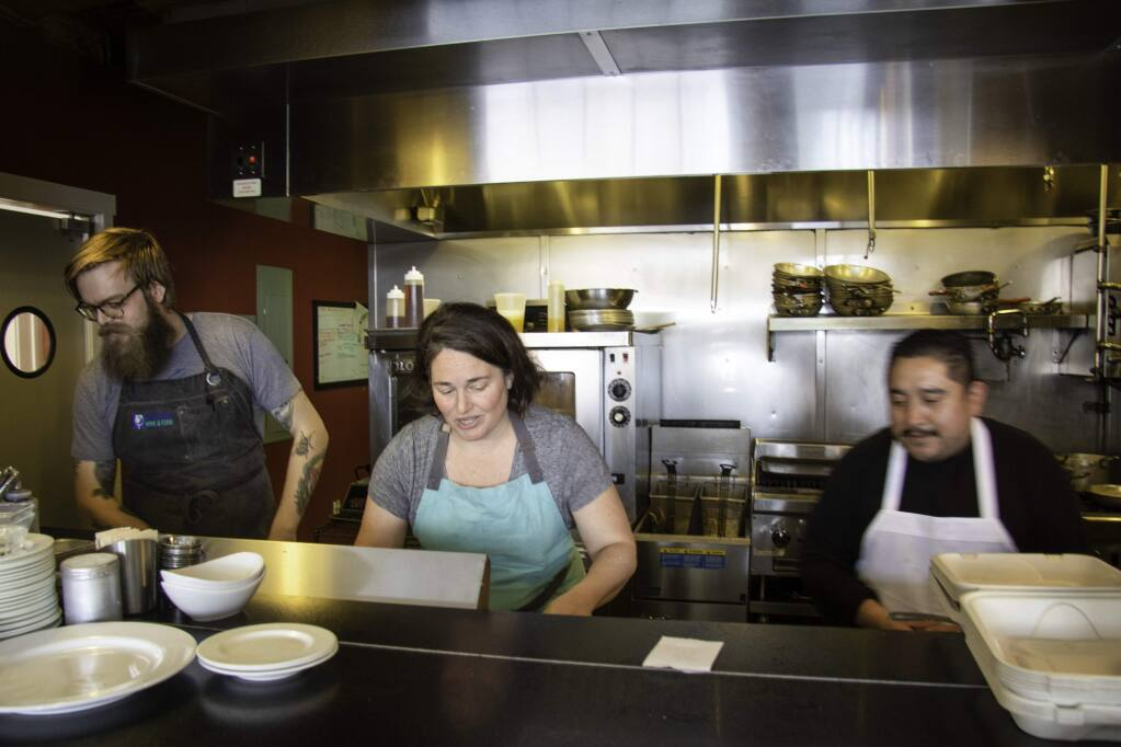 Chef Liza Hinman of Spinster Sisters preparing to-go meals. Heather Irwin/PD