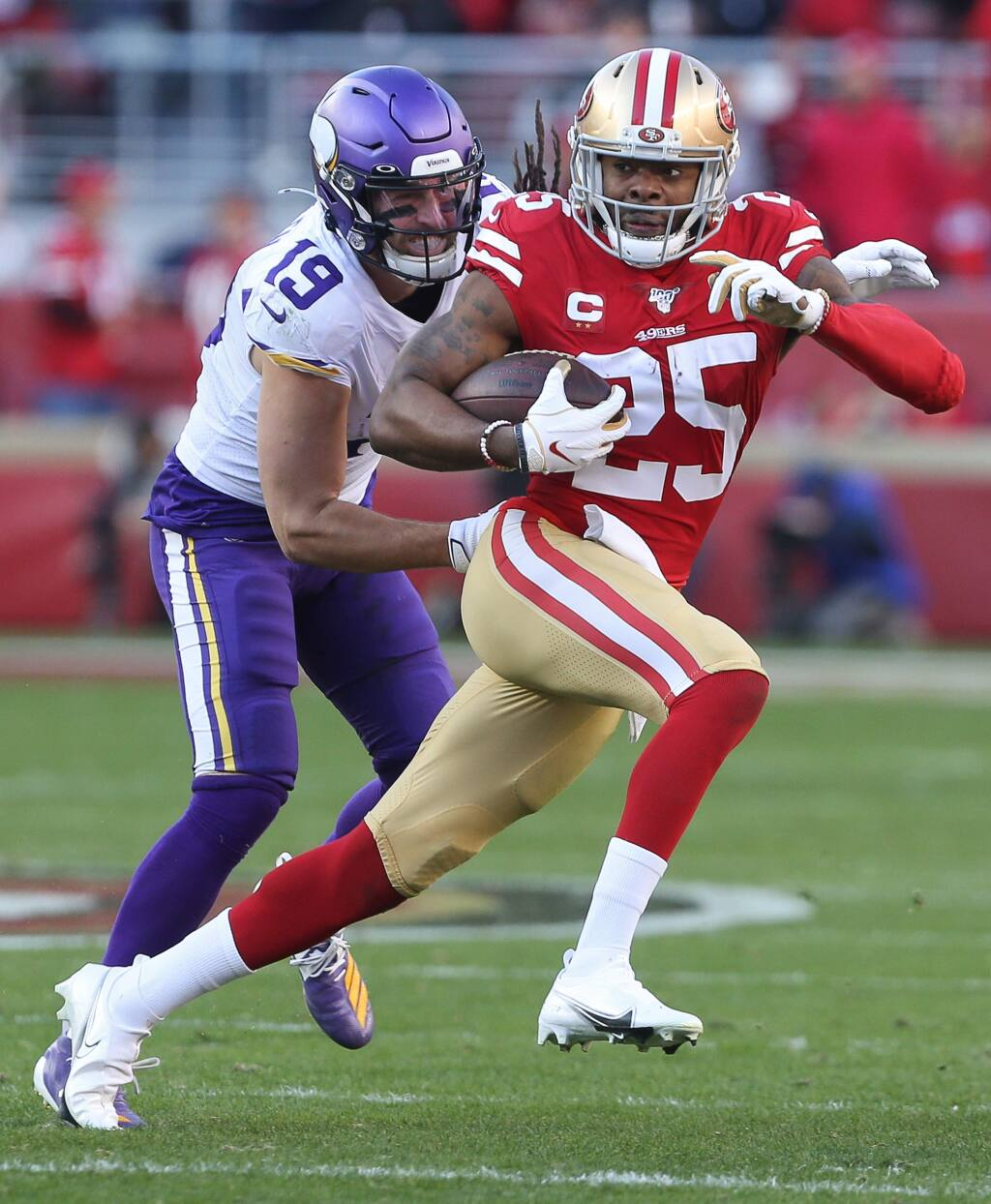 San Francisco 49ers cornerback Richard Sherman runs after intercepting a pass intended for Minnesota Vikings wide receiver Adam Thielen during their NFC divisional playoff game at Levi's Stadium in Santa Clara on Saturday, January 11, 2020. The 49ers defeated the Vikings 27-10.(Christopher Chung/ The Press Democrat)