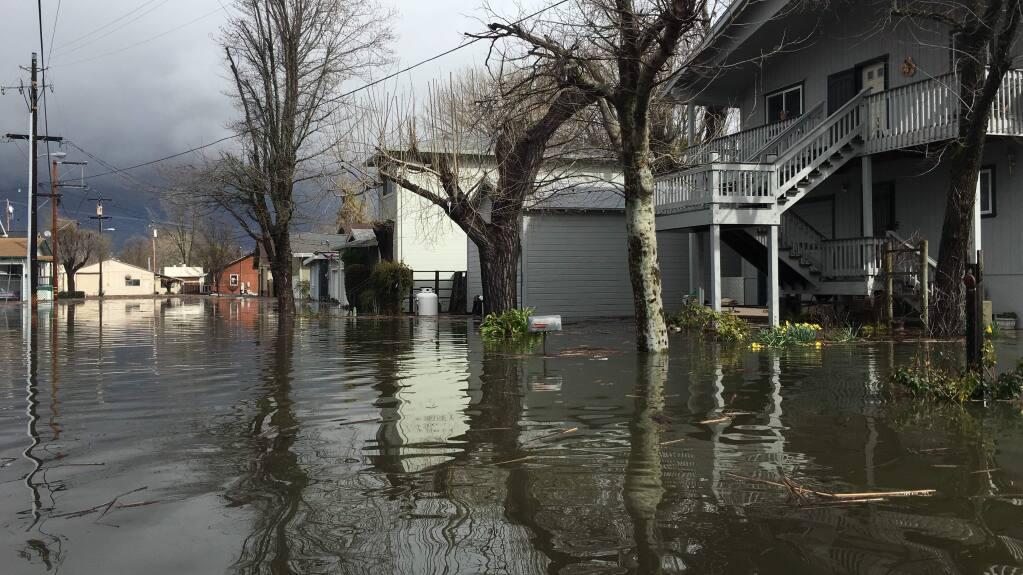 Flooding on Esplanade Street in Lakeport, Tuesday, Feb. 21, 2017. (Kent Porter / Press Democrat)