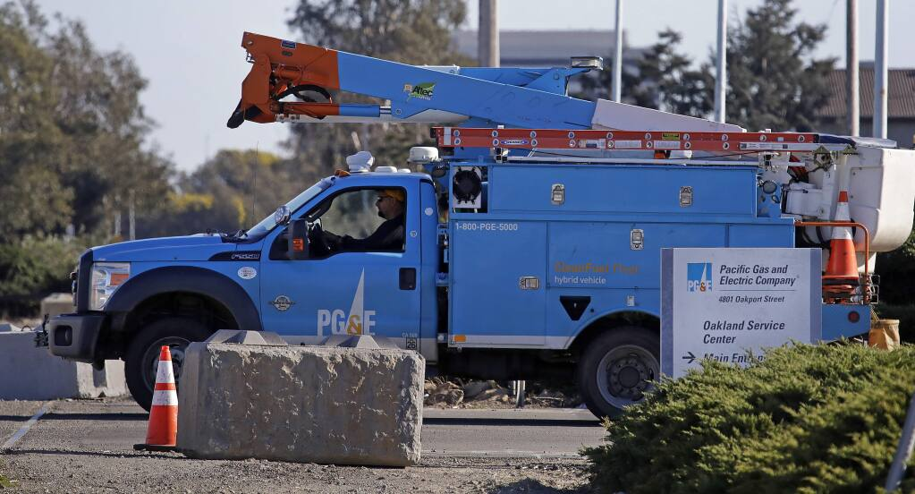 A Pacific Gas & Electric truck leaves the company's Oakland Service Center in Oakland.  (Ben Margot / Associated Press, 2020)
