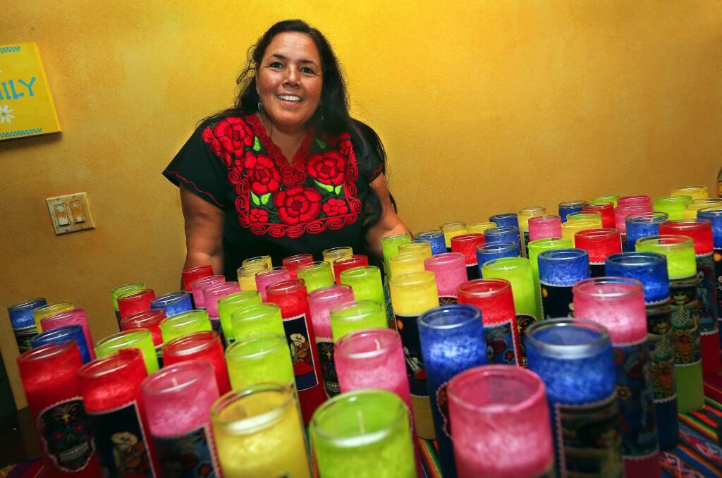 John Burgess / The Press DemocratCorazon de Healdsburg Executive Director Leticia Romero made candles for the Dia de Los Muertos kickoff party for the organization.