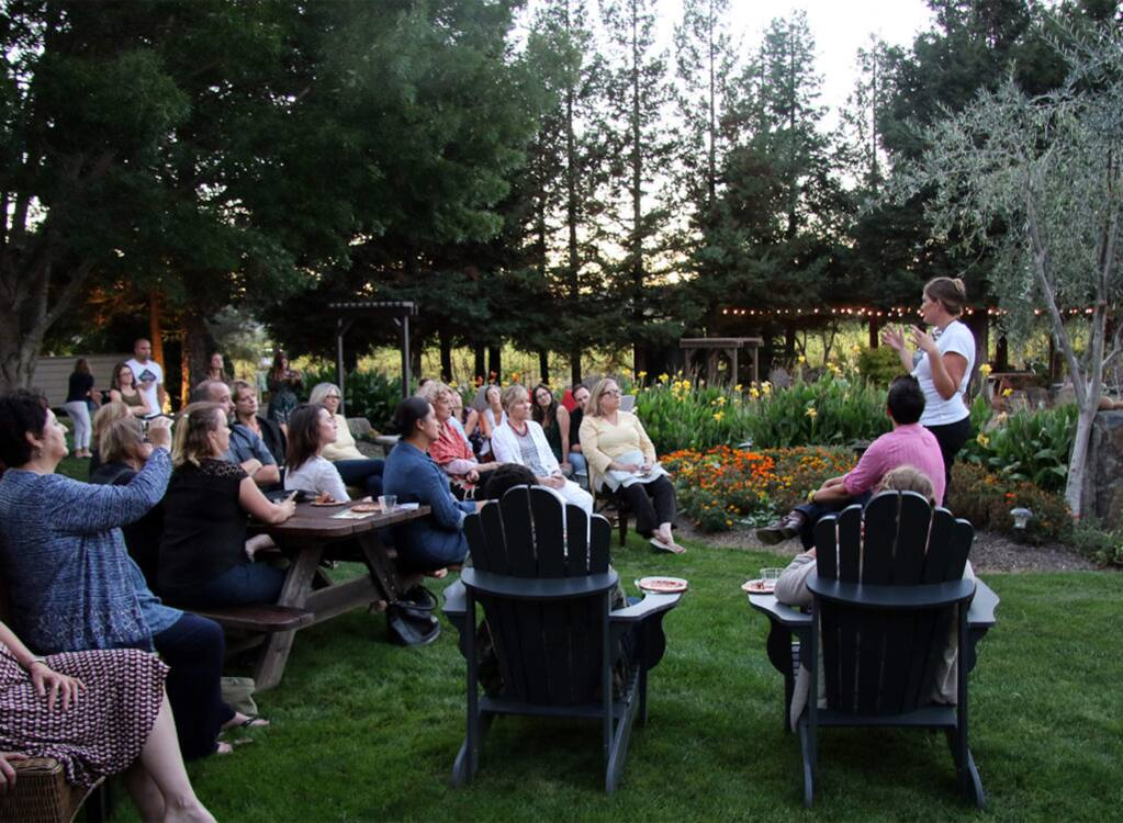An invite-only gathering for women hosted by Garden Society CEO Erin Gore, right, standing, at a private home is aimed at women who are seeking relief from both everyday stresses and deeper discomfort associated with chronic pain and aging. Gore's Santa Rosa-based marijuana edibles company uses social gatherings like this to both inform and engage a growing audience of cannabis users. (HEATHER IRWIN/ PD)