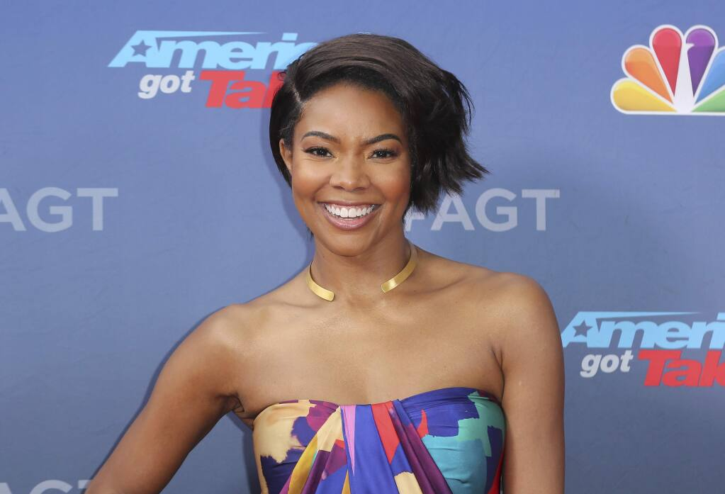 "FILE - This March 11, 2019 file photo shows Gabrielle Union at the 'America's Got Talent' Season 14 Kickoff in Pasadena, Calif. Union is thanking supporters for defending her amid reports she was fired from ""America's Got Talent"" after complaining about racism and other on-set issues. Without directly addressing her status with NBC's talent show, the actress tweeted Wednesday that the backing helped overcome feeling of being lost and alone. (Photo by Willy Sanjuan/Invision/AP, File)"