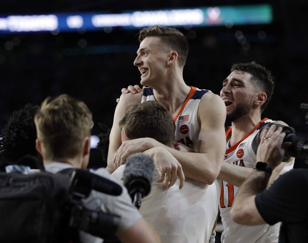 Virginia's Kyle Guy celebrates after defeating Auburn 63-62 in the semifinals of the Final Four at the NCAA Tournament, Saturday, April 6, 2019, in Minneapolis. (AP Photo/David J. Phillip)