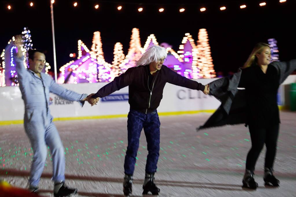 Austin Carrier, left, Alex Mutter-Rottmayer and Caitlin Boucher hold hands as they ice skate at Cornerstone Sonoma in Sonoma, California on Friday, December 8, 2017. (Alvin Jornada / The Press Democrat)