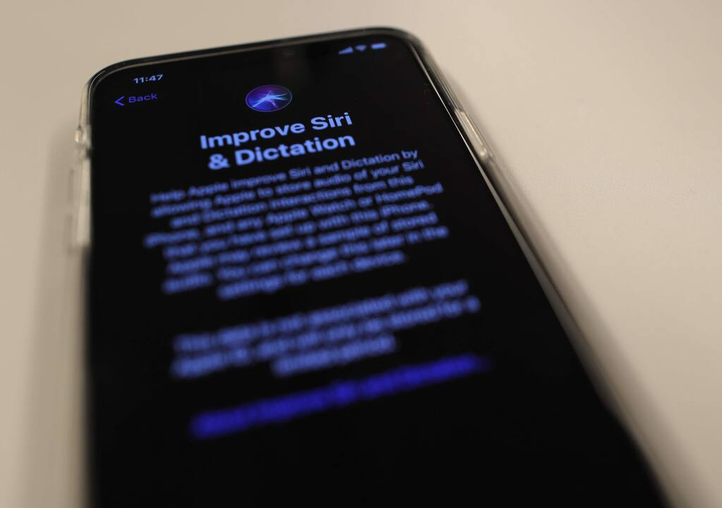 """A screen displays a notice when installing the update, iOS 13.2 on an iPhone on Tuesday, Oct. 29, 2019, in New York. Apple is resuming the use of humans to review Siri commands and dictation with the latest iPhone software update. Individuals can choose """"Not Now"""" to decline audio storage and review. (AP Photo/Jenny Kane)"""