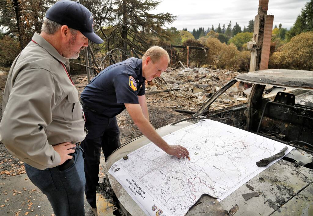 Cal Fire Battalion Chief Paul Fleckenstein, right, shows a map of the fire zones to Sonoma County 4th District Supervisor James Gore Thursday October 19th, 2017. (Photo Will Bucquoy/for the Press Democrat).