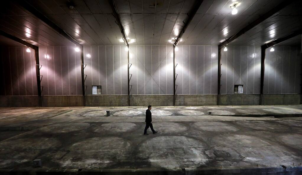 Flow Cana property director Sean Quinn stands in a former Fetzer Winery tank room the Flow Cannabis Institute plans to convert into a three story marijuana drying and processing facility. (John Burgess/The Press Democrat)