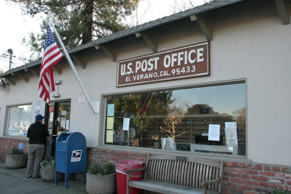 An El Verano resident reads the sign on the door of the local Post Office, announcing the facility is closed due to 'unforeseen circumstances' as of Friday, Jan. 25. (Christian Kallen/Index-Tribune