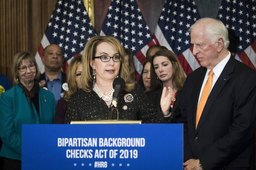 Former Rep. Gabby Giffords and Rep. Mike Thompson at Tuesday's news conference unveiling legislation requiring a background check on all firearms sales. (SARAH SILBIGER / New York Times)
