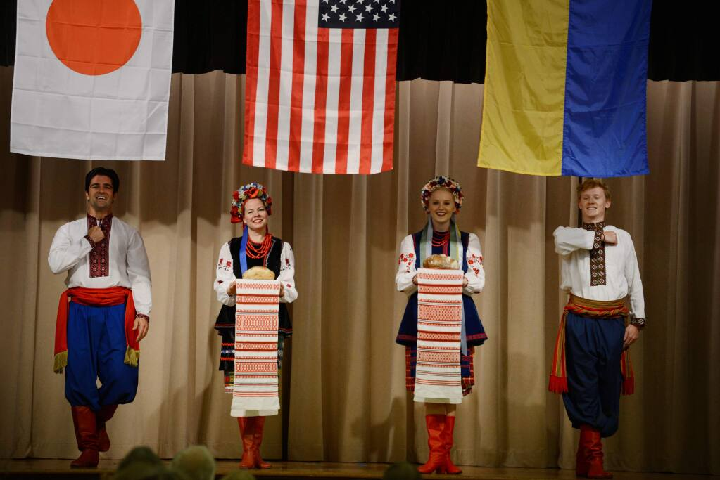 Members of the Burevisnyky Ukrainian Dance Ensemble performing beneath the Japanese, American and Ukrainian flags during the Sister City Friendship Dinner held at the Enmanji Buddhist Temple in Sebastopol, California. The fundraising event celebrates Sebastopol's sister city relationships with Takeo, Japan and Chyhyryn, Ukraine. November 3, 2018.(Photo: Erik Castro/for The Press Democrat)