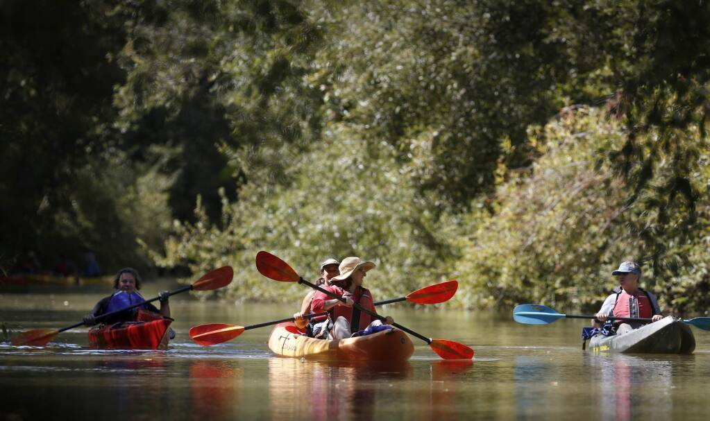 Members of a float trip organized Supervisor James Gore and LandPaths float down the Russian River near Vichy Springs Road as part of the start of a year-long effort to plot the future of the Russian River in Ukiah, on Wednesday, August 24, 2016. (BETH SCHLANKER/ The Press Democrat)
