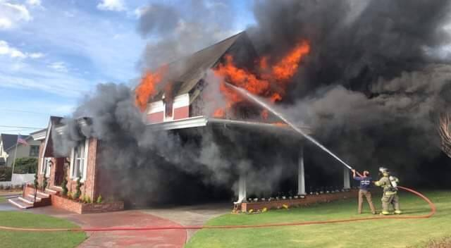 Firefighters battle a blaze at Chapel by the Sea in Fort Bragg on Saturday, Jan. 12, 2019. (BRITTANEY ALBONICO DONDANVILLE)