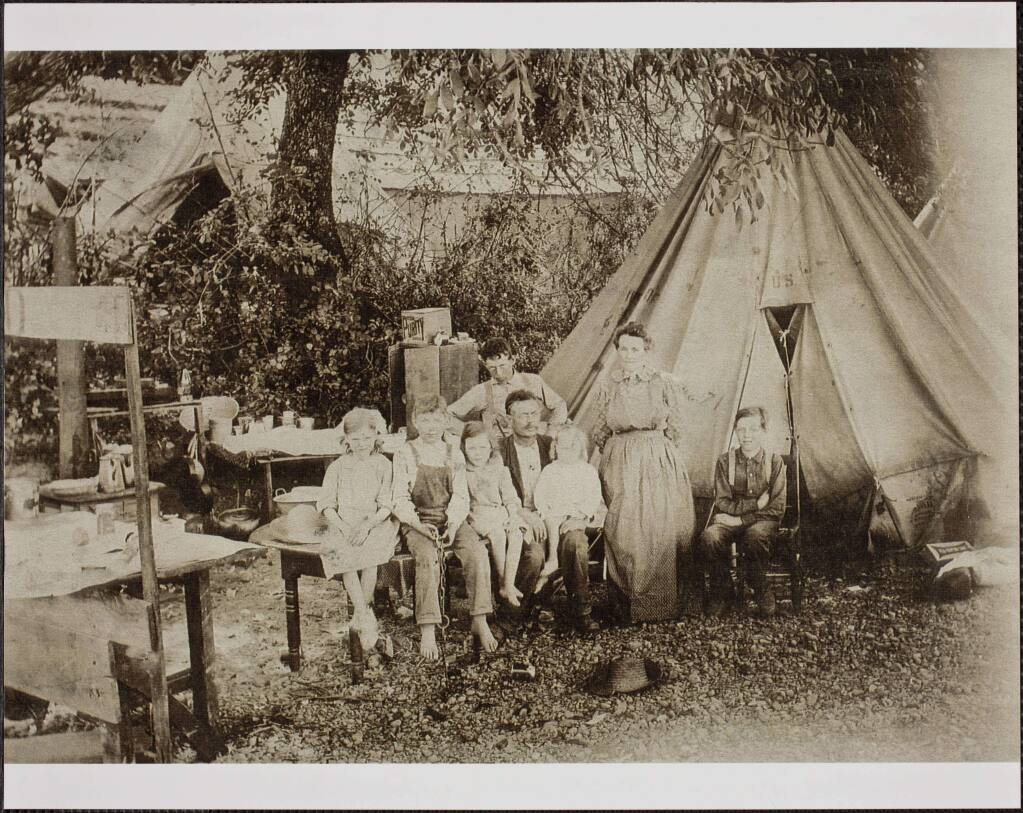 The Hollingsworth family poses in a migrant farm worker camp near Hopland, circa 1906. Seated left to right: Veda Jeanette (1899-1997); Harry Mervyn (1897-1963); Wilma Lynn (1902-1959); William Theron, father (1868-1922) Jack Morton, seated on father's lap (1904-1970); Arthur Rollin, standing behind father (1891-1961) Ida Eliza, mother, standing (1863-1944) Grover Geary, seated in a chair (1893-1968). (Rodd Collection, Sonoma County Library)
