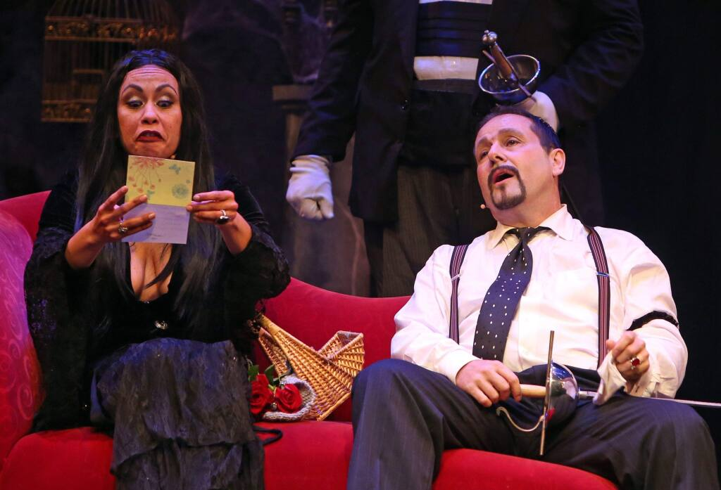 CREEPY & KOOKY - Morticia (Serena Elize Flores) and Gomez (Peter Downey) react to some bad news in 'The Addams Family Musical,' at Spreckels Performing Arts Center.