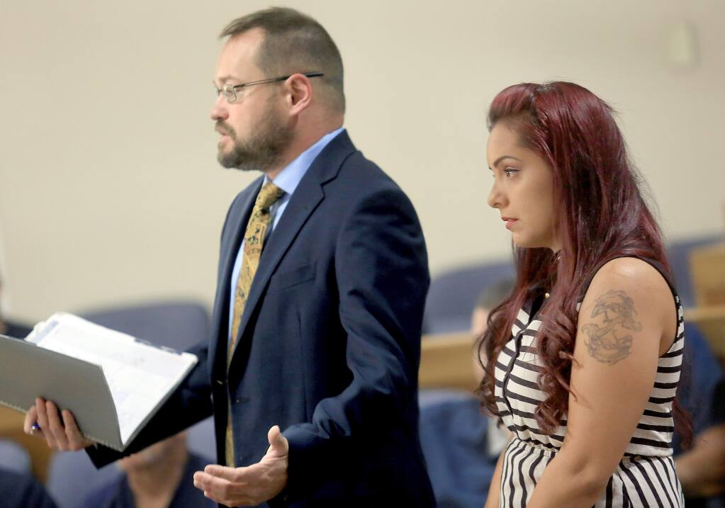 Ben Adams, left, the attorney for Delia Garcia-Bratcher, right, who is accused of grabbing the throat of a 12-year-old boy while confronting him on an elementary school campus about bullying her daughter, reacts to the District Attorney's request to postpone filing charges, Thursday July 17, 2014 in Sonoma County Superior Court in Santa Rosa. (Kent Porter / Press Democrat) 2014