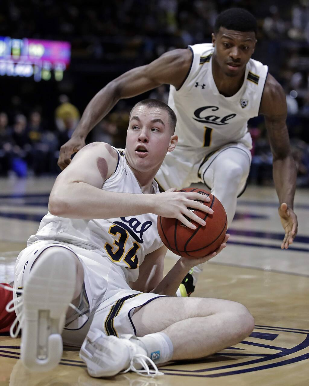 Cal's Grant Anticevich (34) looks to pass from the floor during the first half against USC on Saturday, Feb. 16, 2019, in Berkeley. (AP Photo/Ben Margot)