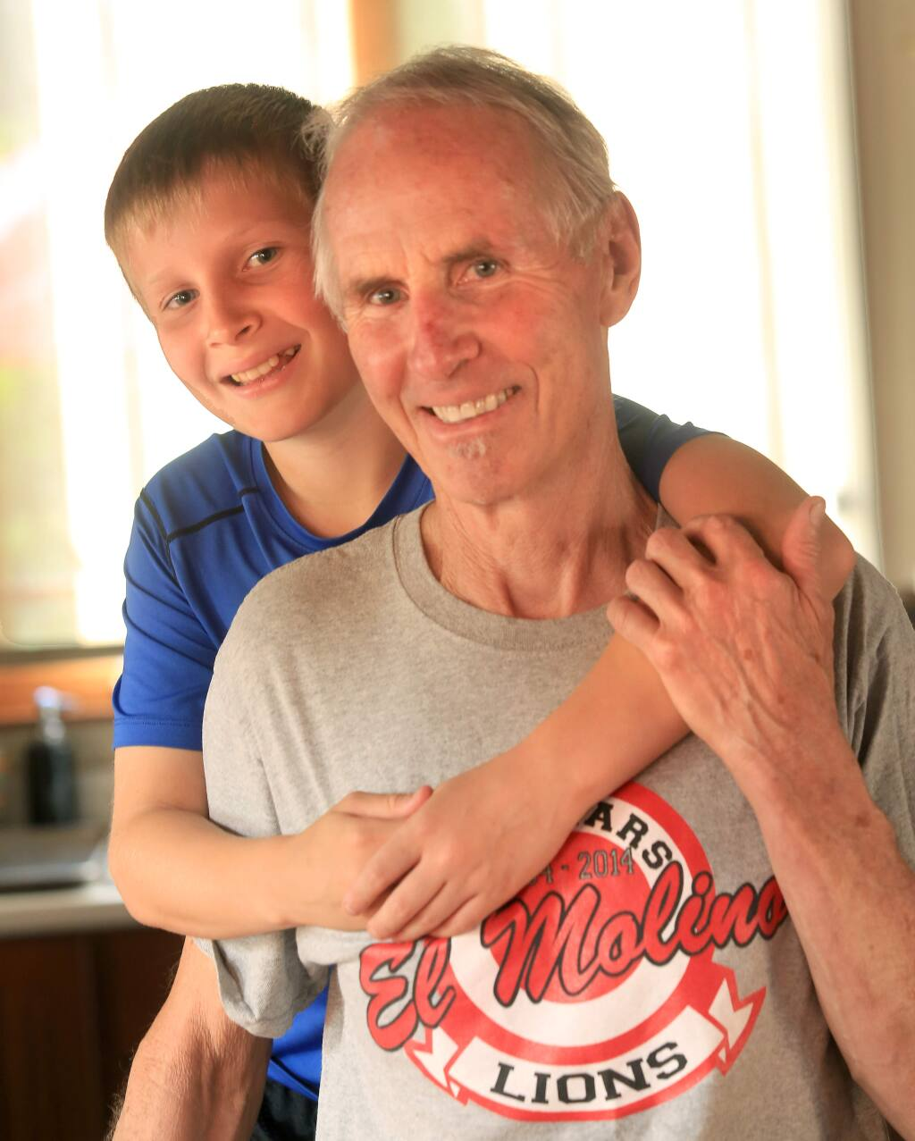Lewis Griffith, 13, saved his dad Steve Griffith from a heart attack, by using chest compressions, a technique he learned from a class at Forestville Academy, Wednesday Oct. 1, 2014 in Forestville. (Kent Porter / Press Democrat) 2014