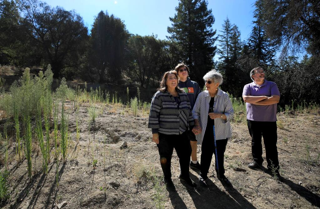 Lisa Frazee, son Carl, 16, mom, Gloria Sanchez, and Howard Frazee at their Tubbs fire Wikiup lot on Saturday, Sept. 21, 2019. (KENT PORTER/ PD)