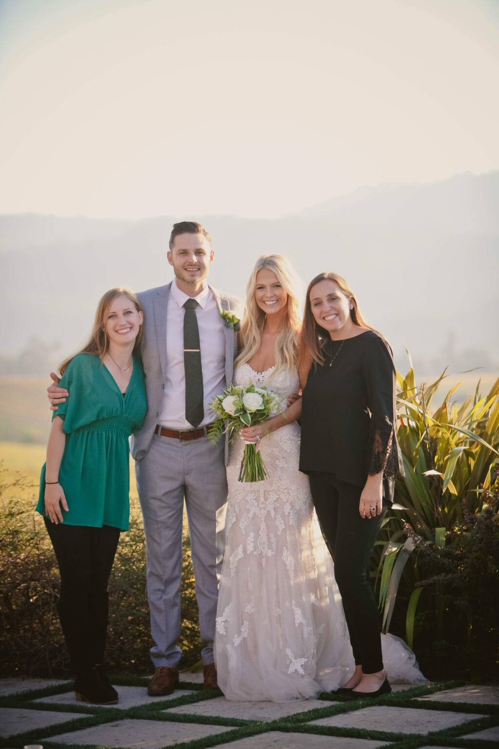 Wedding planners Kalika Ansel (far left) and Brittany Rogers-Hanson (far right) with groom Will White and bride Harrison Sap who, with Hanson's support, overcame obstacles to have their Wine Country wedding Wednesday. (photo courtesy of Runawaywithme weddings)