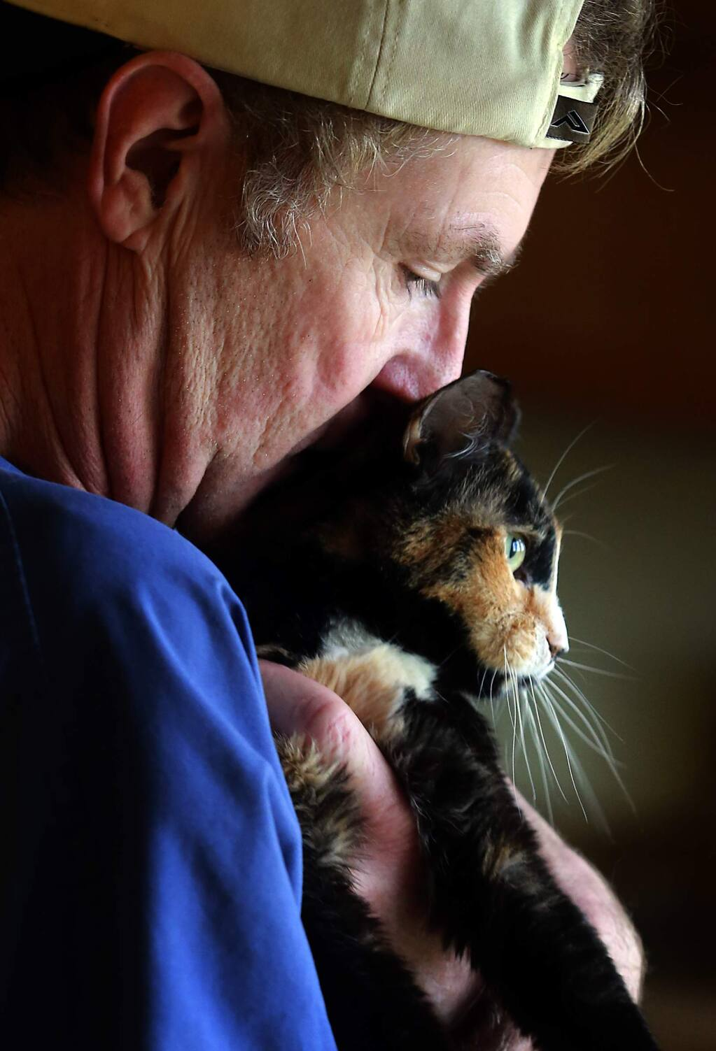 PHOTO: 2 by JOHN BURGESS / The Press Democrat -Darryl Roberts snuggles with Pumpkin, who is afflicted with cerebellar hypoplasia and has difficulties walking. Roberts founded SNAP Cats for abused, injured and disabled cats out of his Dry Creek apartment.