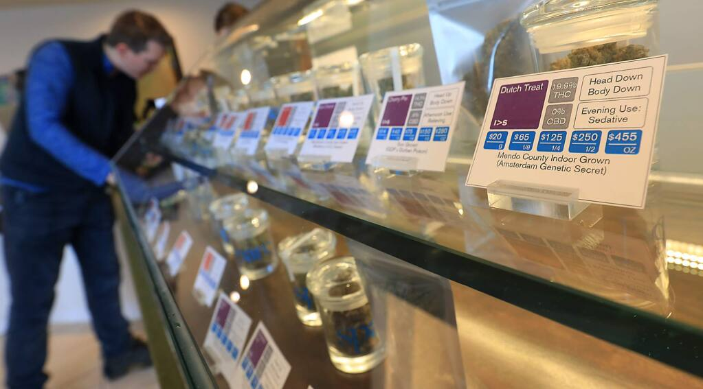 Jesse Knapp of Santa Rosa left, looks to purchase products at SPARC Cannabis Clinic in Santa Rosa on Monday Jan. 22, 2018, (KENT PORTER/ PD FILE)